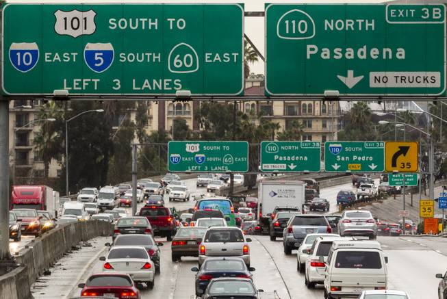 In this Thursday, Feb. 6, 2014, photo, traffic on the eastbound Hollywood Freeway approaches the four-level interchange in downtown Los Angeles. A California Department of Transportation report ranks Interstate 5 in Los Angeles County as the most congested highway in the state.