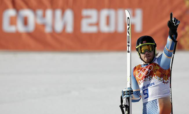 Norway's Kjetil Jansrud gestures from the finish area after finishing the downhill portion of the men's supercombined at the Sochi 2014 Winter Olympics, Friday, Feb. 14, 2014, in Krasnaya Polyana, Russia.