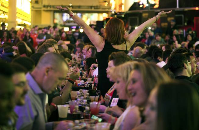 A single woman motions to organizers there is no man across the table from her at the D Date-a-thon outside the D Las Vegas along the Fremont Street Experience on Friday, Feb. 14, 2014.  L.E. Baskow