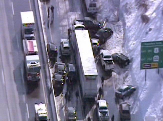 This video frame grab provided by Fox 29 Philadelphia shows traffic accidents involving multiple tractor trailers and dozens of cars on Pennsylvania Turnpike outside Philadelphia, on Friday, Feb. 14, 2014.  The crashes were reported just after 8 a.m. Friday, one day after the area got about a foot of snow that left roads slick. Television news helicopter footage showed several tractor-trailers and dozens of cars involved in a series of accidents that had backed up traffic for miles between the Bensalem and Willow Grove exits.