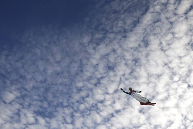 Australia's Samantha Wells catches air during a training session for the women's freestyle skiing aerials at the Rosa Khutor Extreme Park, at the 2014 Winter Olympics, Friday, Feb. 14, 2014, in Krasnaya Polyana, Russia. (AP Photo/Jae C. Hong)