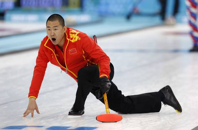 China's skip Liu Rui shouts to his weepers after delivering the rock during men's curling competition against Norway at the 2014 Winter Olympics, Friday, Feb. 14, 2014, in Sochi, Russia.
