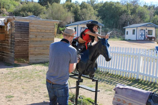 "Melody Sweets, in costume, on set at Grand Canyon Ranch in April 2013 for the filming of her video for the song, ""Shoot 'em Up."""