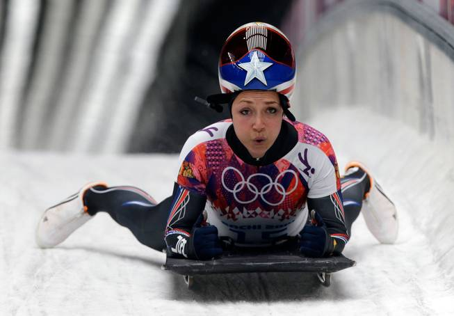 Katie Uhlaender of the United States brakes after her final run during the women's skeleton competition at the 2014 Winter Olympics, Friday, Feb. 14, 2014, in Krasnaya Polyana, Russia.