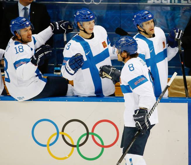 Finland forward Teemu Selanne (8) is congratulated by his teammates after scoring a goal against Norway during the 2014 Winter Olympics men's ice hockey game at Shayba Arena, Friday, Feb. 14, 2014, in Sochi, Russia.
