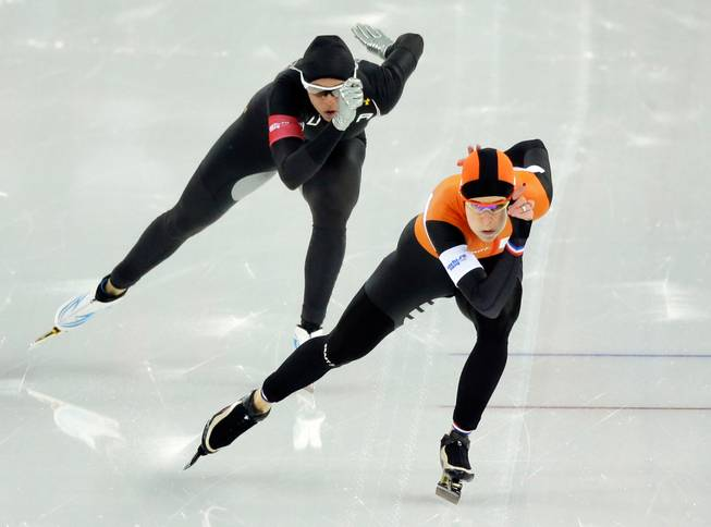 In this Thursday, Feb. 13, 2014 file photo, Brittany Bowe of the United States, left, trails behind silver medallist Ireen Wust of the Netherlands in the women's 1,000-meter speedskating race at Adler Arena during the 2014 Winter Olympics in Sochi, Russia.