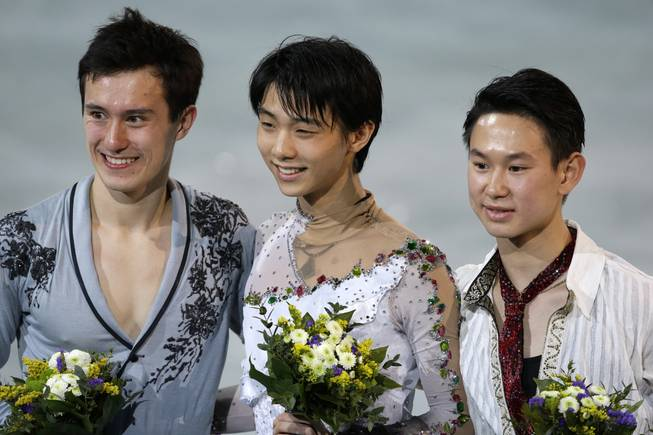 Patrick Chan of Canada, Yuzuru Hanyu of Japan and Denis Ten of Kazakhstan stand on the podium during the medal ceremony for the men's free skate figure skating final at Iceberg Skating Palace during the 2014 Winter Olympics, Friday, Feb. 14, 2014, in Sochi, Russia.