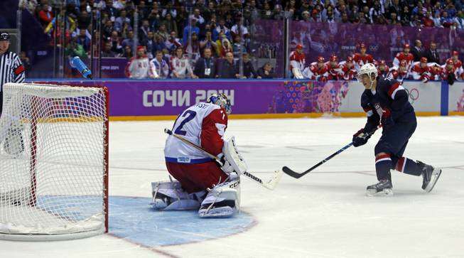 USA forward T.J. Oshie scores the winning goal against Russia goaltender Sergei Bobrovsky in a shootout during overtime of a men's ice hockey game at the 2014 Winter Olympics, Saturday, Feb. 15, 2014, in Sochi, Russia.