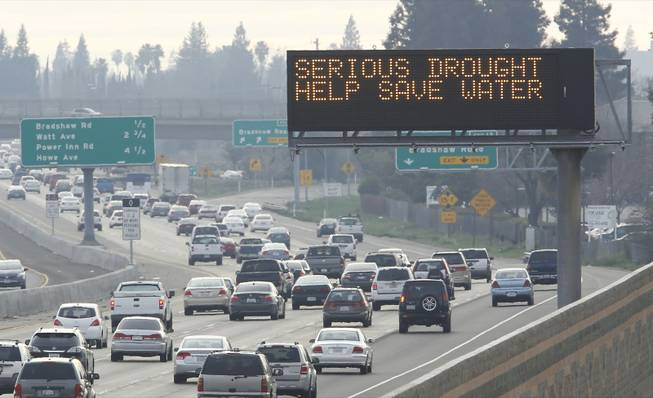 In this photo taken Wednesday, Feb. 12, 2014, a sign on westbound Highway 50 in Sacramento,  normally used to warn drivers of traffic problems or display Amber Alert messages, displays a message to conserve water due to California's drought. Gov. Jerry Brown was governor the last time California had a drought of epic proportions, in 1975-76, and now is pushing a controversial $25 billion plan to build twin tunnels to ship water from the Sacramento-San Joaquin River Delta to farmland and cities further south.