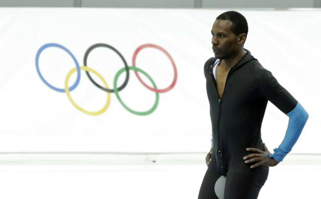 Shani Davis of the U.S. takes a breather after competing in the men's 1,500-meter speedskating race at the Adler Arena Skating Center during the 2014 Winter Olympics in Sochi, Russia, Saturday, Feb. 15, 2014.