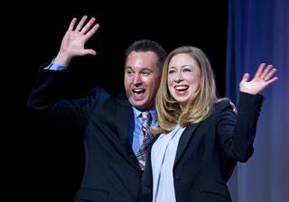 Vinnie Pompei, conference chair and director of the Human Rights Campaign Foundation's Youth Well-Being Project, and Chelsea Clinton wave after closing remarks during HRC's Time to Thrive conference at Bally's on Sunday, Feb. 16, 2014.