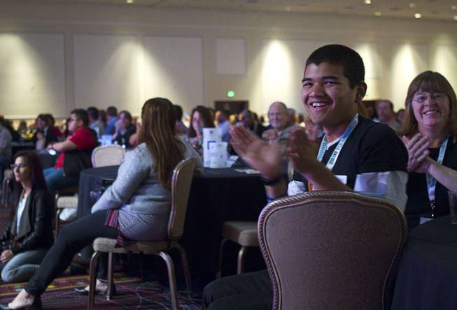 Tom Wongaiyara, right, 16, applauds during the Human Rights Campaign's Time to Thrive conference at Bally's on Sunday, Feb. 16, 2014.