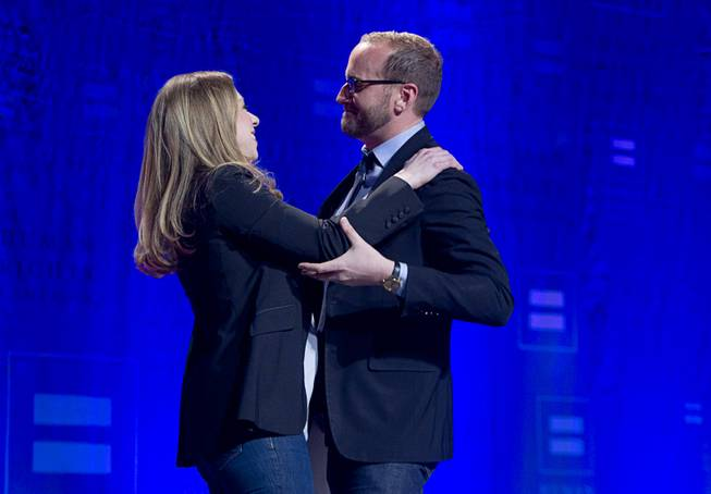 Chelsea Clinton is greeted by Chad Griffin, president of the Human Rights Campaign, as she arrives to give closing remarks during HRC's Time to Thrive conference at Bally's on Sunday, Feb. 16, 2014.
