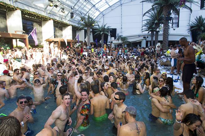 Partygoers crowd the pool during the Halfway to EDC and first winter pool party at Marquee Dayclub on Sunday, Feb. 16, 2014, in the Cosmopolitan of Las Vegas.