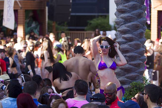 A woman dances during the Halfway to EDC and first winter pool party at Marquee Dayclub on Sunday, Feb. 16, 2014, in the Cosmopolitan of Las Vegas.