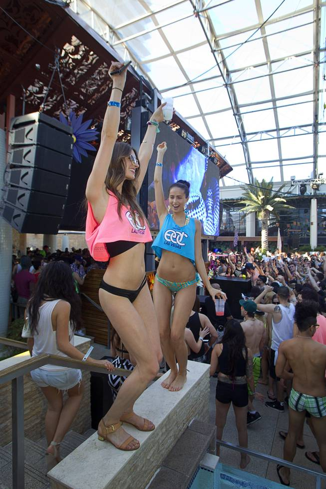 Lis (no last name given) and Coco Hunter, both of Los Angeles, dance during the Halfway to EDC and first winter pool party at Marquee Dayclub on Sunday, Feb. 16, 2014, in the Cosmopolitan of Las Vegas.