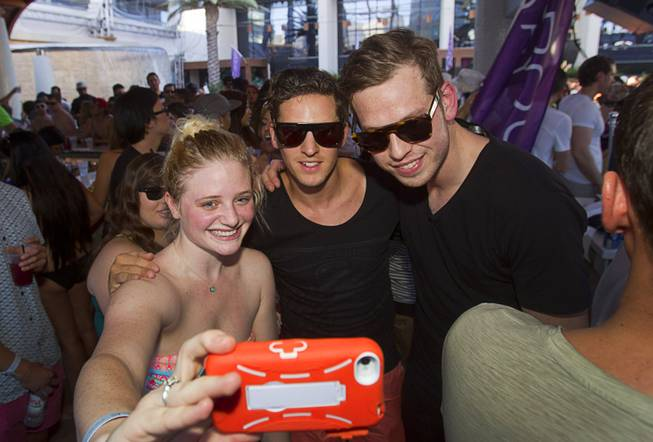 Miranda Sprague takes a selfie with Firebeatz DJs Jurre and Tim during the Halfway to EDC and first winter pool party at Marquee Dayclub on Sunday, Feb. 16, 2014, in the Cosmopolitan of Las Vegas.