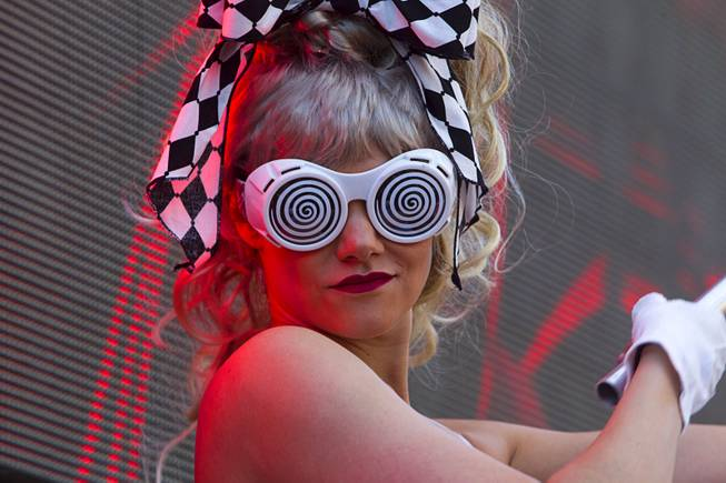 A performer waves a flag during the Halfway to EDC and first winter pool party at Marquee Dayclub on Sunday, Feb. 16, 2014, in the Cosmopolitan of Las Vegas.