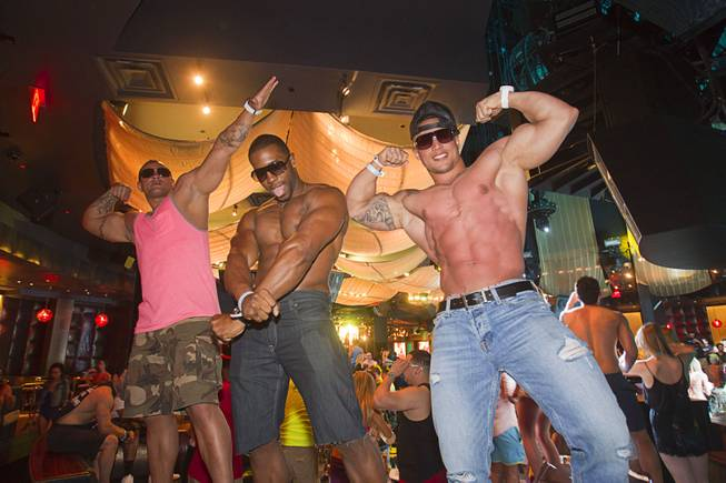 Terry Placker, Patrick Fulgham and Axel Alvarez show off their physiques during the Halfway to EDC and first winter pool party at Marquee Dayclub on Sunday, Feb. 16, 2014, in the Cosmopolitan of Las Vegas.