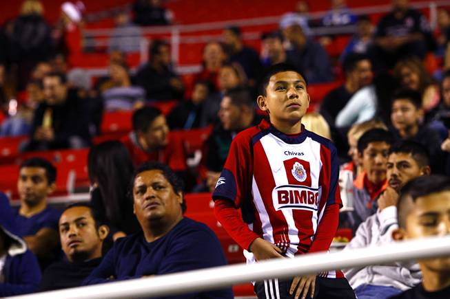 A Chivas fan waits to play to resume at halftime during the 2014 Las Vegas ProSoccer Challenge at Sam Boyd Stadium Sunday, Feb. 16, 2014. Chivas USA (Los Angeles) beat the Colorado Rapids 2-1.