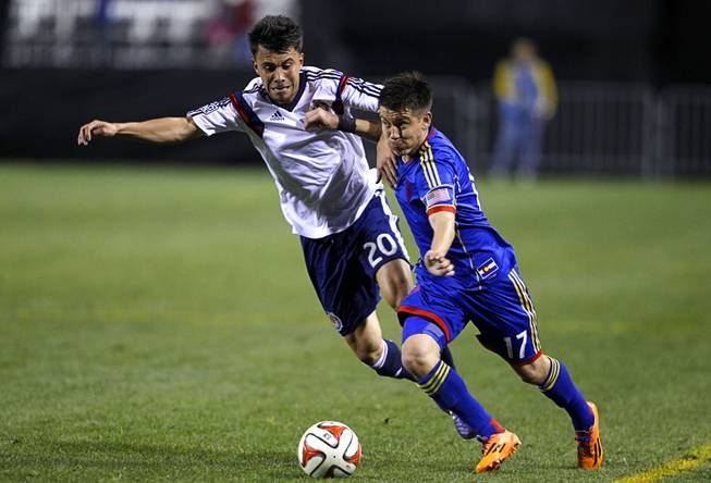 Chivas USA's Carlos Alvarez, left, and Colorado's Dillon Serna fight for the ball during the 2014 Las Vegas ProSoccer Challenge at Sam Boyd Stadium Sunday, Feb. 16, 2014. Chivas USA (Los Angeles) beat the Colorado Rapids 2-1.