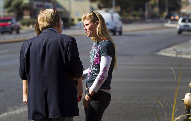 Volunteers looking for information on Jessie Foster talk with a woman who had been panhandling on the corner of Jones Boulevard and Tropicana Avenue Monday, Feb. 17, 2014. Foster, a Canadian, went missing from North Las Vegas in 2006.