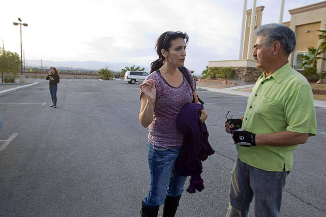 Shannon Forsythe, executive director of Run 2 Rescue, gets directions from Benjamin Gonzalez, a maintenance man at East Vegas Christian Center, Monday, Feb. 17, 2014. Forsythe and Mary Borchers, left are looking for information on Jessie Foster, a Canadian, who went missing in 2006. She had been living in North Las Vegas.