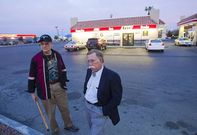 Volunteers Barry Mainardi, left, a chaplain with Messages of Faith Ministry, and Edward Cotton wait outside a Rebel Station during a search for information on Jessie Foster continues Monday, Feb. 17, 2014. Foster, a Canadian, went missing from North Las Vegas in 2006.