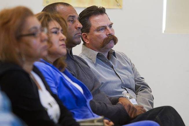 Pastor Troy  Martinez, right, listens to a morning briefing about missing woman Jessie Foster at East Vegas Christian Center Monday, Feb. 17, 2014. A new search is going on for Foster, a Canadian, who went missing in 2006. She had been living in North Las Vegas.