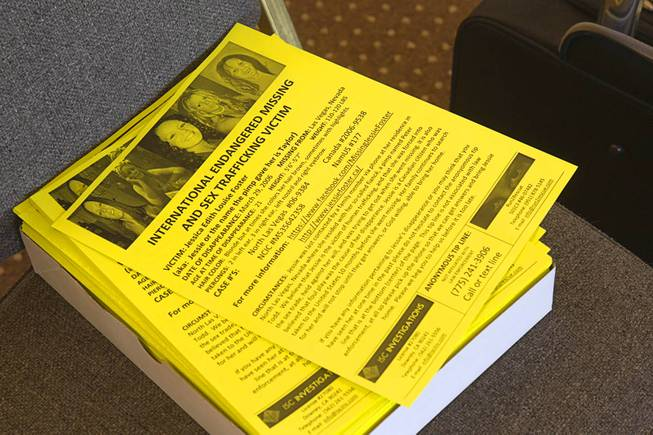 Stacks of fliers on Jessie Foster are shown at East Vegas Christian Center during a morning briefing for volunteers Monday, Feb. 17, 2014.  A new search is going on for Foster, a Canadian, who went missing in 2006. She had been living in North Las Vegas.
