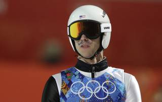 United States' Nicholas Alexander sports a mustache-shaped American flag painted in his face during the ski jumping large hill team competition at the 2014 Winter Olympics, Monday, Feb. 17, 2014, in Krasnaya Polyana, Russia.