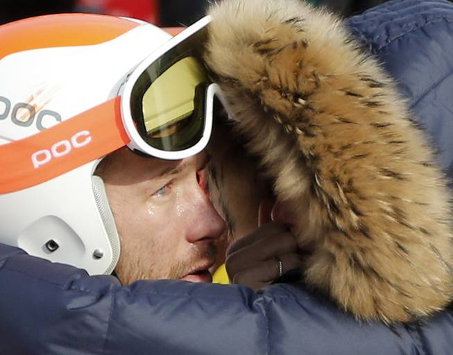 Men's super-G joint bronze medal winner Bode Miller of the United States is consoled by his wife, Morgan, at the Sochi 2014 Winter Olympics, Sunday, Feb. 16, 2014, in Krasnaya Polyana, Russia.