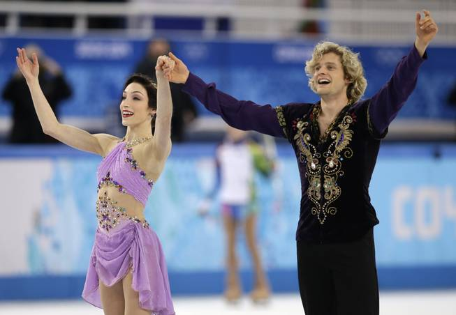 Meryl Davis and Charlie White of the United States acknowledge the crowd after completing their routine in the ice dance free dance figure skating finals at the Iceberg Skating Palace during the 2014 Winter Olympics, Monday, Feb. 17, 2014, in Sochi, Russia.