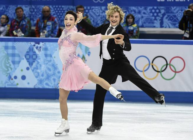 Meryl Davis, left, and Charlie White, of the United States, compete in the ice dance short dance figure skating competition at the Iceberg Skating Palace during the Winter Olympics, Sunday, Feb. 16, 2014, in Sochi, Russia.