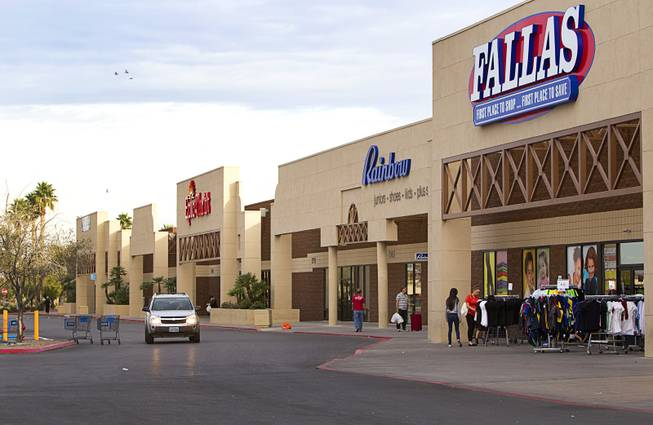 Shoppers look over clothing at a shopping center on East Tropicana Avenue near Pecos Road Tuesday, Feb. 18, 2014. The shopping center had been decline during the recession but is now recovering and adding tenants.