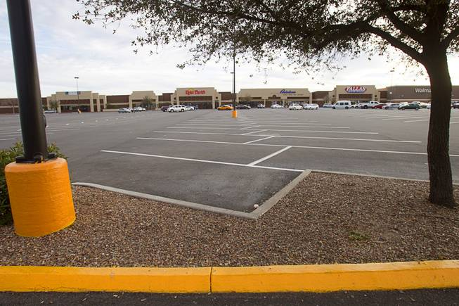 A view of a shopping center parking lot on East Tropicana Avenue near Pecos Road Tuesday, Feb. 18, 2014. The shopping center had been decline during the recession but is now recovering and adding tenants.