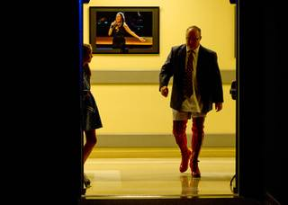 Myron Martin, president/CEO of the Smith Center for the Performing Arts, walks to the stage in kinky boots as he announces the 2014-2015 Broadway Las Vegas Series at the Center Tuesday, Feb. 18, 2014. The Tony Award-winning