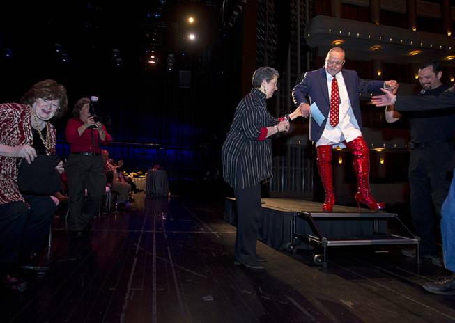 "Myron Martin, president/CEO of the Smith Center for the Performing Arts, gets help leaving the stage after announcing the 2014-2015 Broadway Las Vegas Series at the Center Tuesday, Feb. 18, 2014. The Tony Award-winning ""Kinky Boots"" will be coming to the Smith Center in September."