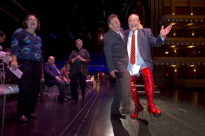 "Myron Martin, president/CEO of the Smith Center for the Performing Arts, wears kinky boots as poses with Steve Schorr after announcing the 2014-2015 Broadway Las Vegas Series at the Center Tuesday, Feb. 18, 2014. The Tony Award-winning ""Kinky Boots"" will be coming to the Smith Center in September."