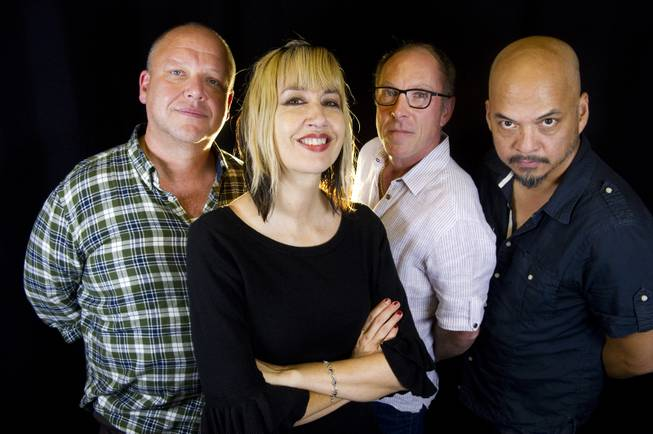 Rock band Pixies, from left, Black Francis, Kim Shattuck, David Lovering and Joey Santiago, in a portrait to promote their new EP and upcoming tour dates, on Friday, Sept. 20, 2013, in New York.