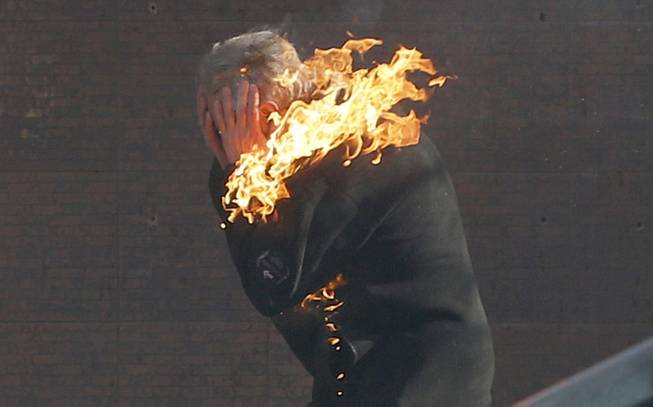 An anti-government protester is engulfed in flames during clashes with riot police outside Ukraine's parliament in Kiev, Ukraine, Tuesday, Feb. 18, 2014.