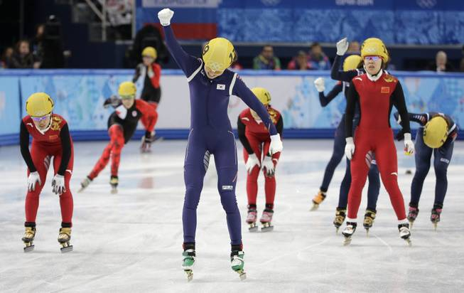 Shim Suk-Hee of South Korea, centre, celebrates her team's first place in the women's 3000m short track speedskating relay final at the Iceberg Skating Palace during the 2014 Winter Olympics, Tuesday, Feb. 18, 2014, in Sochi, Russia.