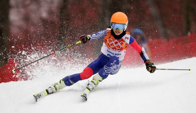 Violinst Vanessa Mae, starting under her father's name as Vanessa Vanakorn for Thailand, makes a turn in the first run of the women's giant slalom at the Sochi 2014 Winter Olympics, Tuesday, Feb. 18, 2014, in Krasnaya Polyana, Russia.