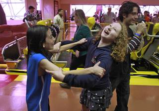 Benjamin de los Santos and Alayna McArthur react after being the first official riders of El Loco roller coaster at Circus Circus Tuesday, Feb. 18, 2014.