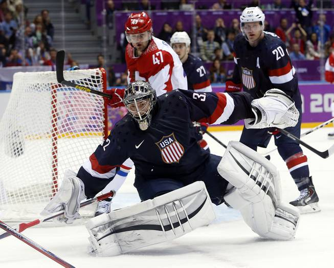 USA goaltender Jonathan Quick comes out of the crease to defend the goal in the third period of a men's ice hockey game at the 2014 Winter Olympics, Saturday, Feb. 15, 2014, in Sochi, Russia.