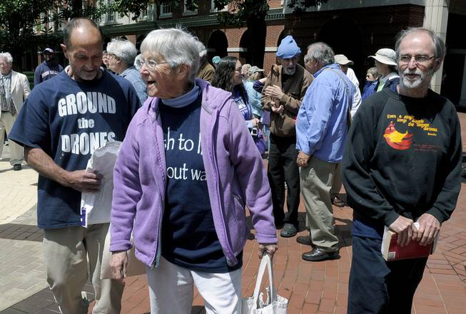 Anti-nuclear weapons activists, from left, Michael Walli, Sister Megan Rice and Greg Boertje-Obed arrive for their trial in Knoxville, Tenn., May 6, 2013.