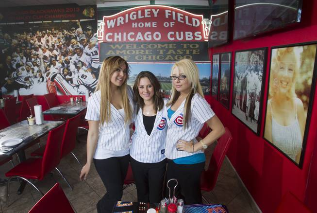Servers, from left, Tiffany Shapouri, Susie Barajas, and Amanda Hewitt pose at Amore Taste of Chicago, 3945 S. Durango Dr., Wednesday, Feb. 19, 2014.