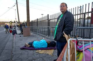 Mike Lora, 33, an unemployed tradesman, waits on Foremaster Lane Wednesday, Feb. 19, 2014. Citing traffic issues on Main Street and Foremaster Lane, Metro Police are considering ways to ease traffic congestion, such as by designating areas for people to make donations to the homeless.