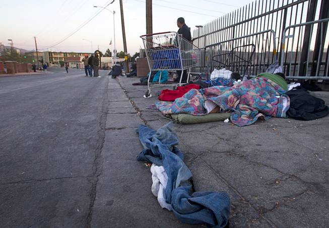 Homeless gather on Foremaster Lane near Main Street Wednesday, Feb. 19, 2014. Citing traffic issues on Main Street and Foremaster Lane, Metro Police are considering ways to ease traffic congestion, such as by designating areas for people to make donations to the homeless.