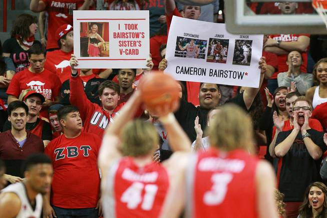 UNLV students try to distract New Mexico forward Cameron Bairstow as he takes a free throw during the first half of their Mountain West Conference game Wednesday, Feb. 19, 2014 at the Thomas & Mack Center.